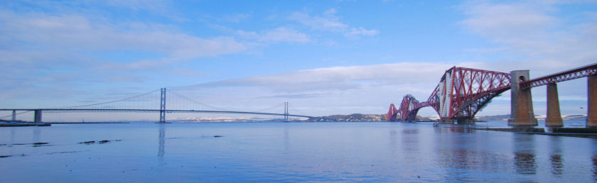 The Forth Road bridge, on the left, and the original Forth Bridge, Scotland
